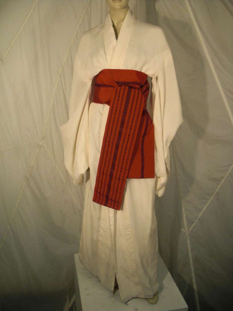 """A beautiful white, wedding worthy, silk kimono: Traditionally cut in micropleated, """"crinkled"""" silk.  Red Obi included with kimono."""