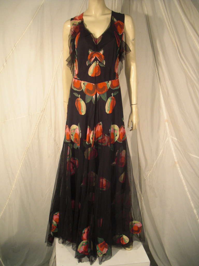 1930s silk net and crepe bias cut gown in an oversized apple print with skirt overlay embellished with print applique.  Can be worn at shoulders also.