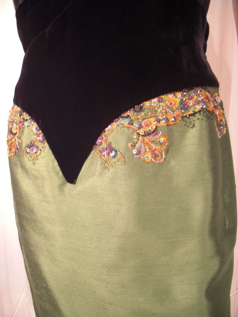 """A gorgeous 1990s numbered Dior Haute Couture cocktail dress by John Galliano:  Micro-pleated silk lace strapless bust, silk velvet """"corset style"""" waist and forest green silk taffeta pencil skirt with beading detail at hip. Very structured inside the"""