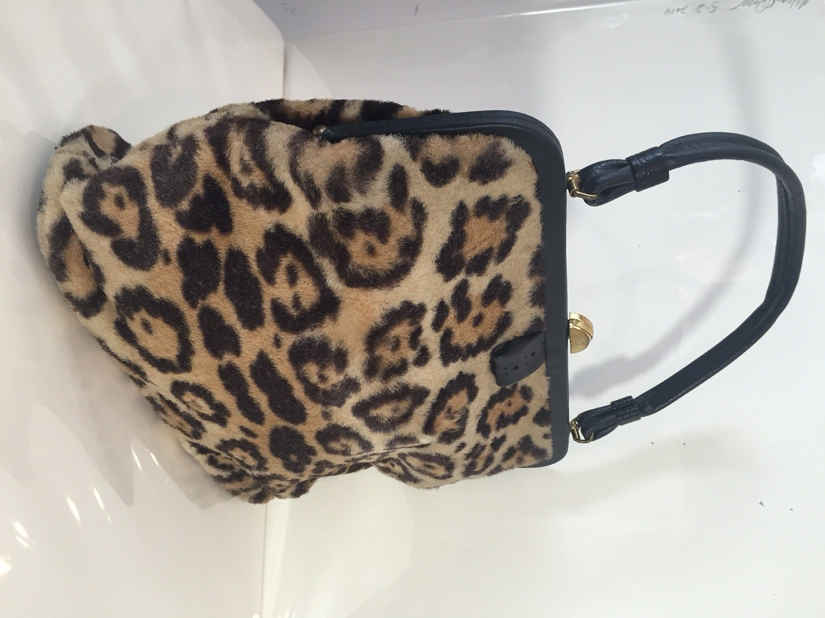 A great 1950s faux fur handbag:  Flat bottom with metal