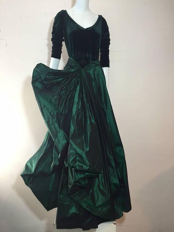 A lovely 1990s Gianfranco Ferre forest green silk taffeta and stretch velvet gown:  bodice is complete body suit with low scoop neckline and snap closure. Skirt is heavily gathered and constructed into a full side pouf ball gown.