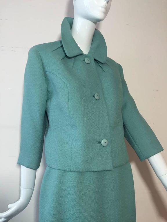 A gorgeous 1950s Jean Lanvin - Castillo turquoise wool skirt suit:  Completely lined in taupe satin. A straight skirt and boxy cut jacket with button closures, princess seaming and featured darting detail at neckline. Originally sold at I. Magnin.