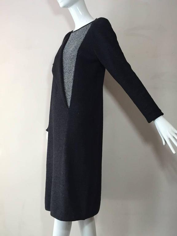 A 1980s Karl Lagerfeld for Chloe gray wool and lurex knit dress:  long sleeves, padded shoulders.  Front panel unbuttons to reveal silver lurex panel. Side slit is backed with lurex for peek-a-boo effect.