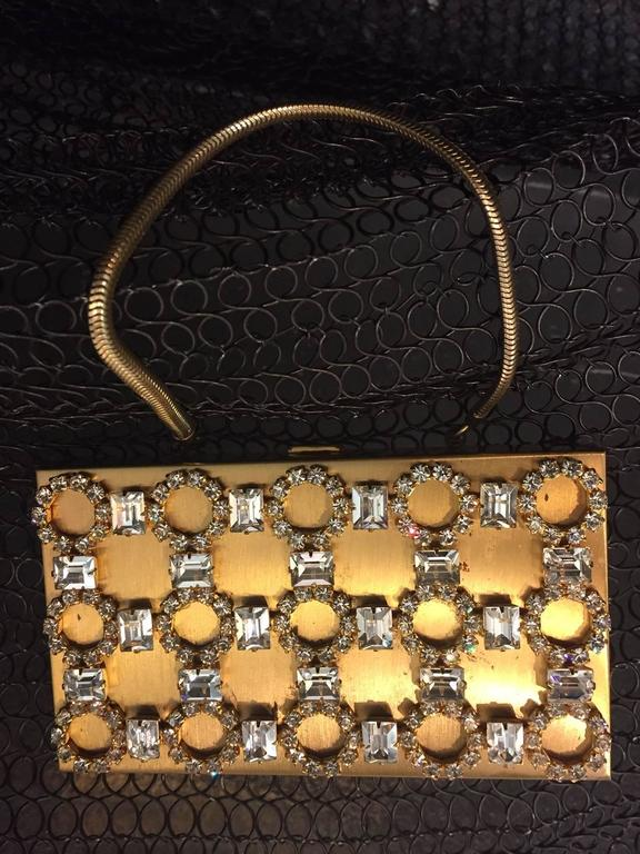 A gorgesou 1950s gold-tone rhinestone encrusted evening compact clutch with chain handle.  Small thin compartment for credit card and key.  Empty lipstick compartment. and