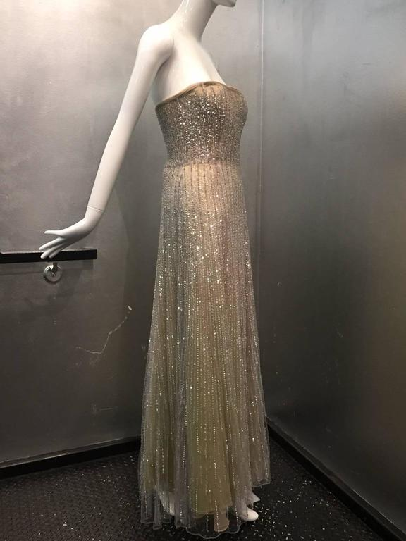 Oscar de La Renta etherial silver tulle gown: Strapless with boned and structured bodice, zippered back.  5-Layer underpinnings in taupe, citrine and silver.  Tulle is sequined and beaded with lame threads.  Unlabeled, by confirmed to have been