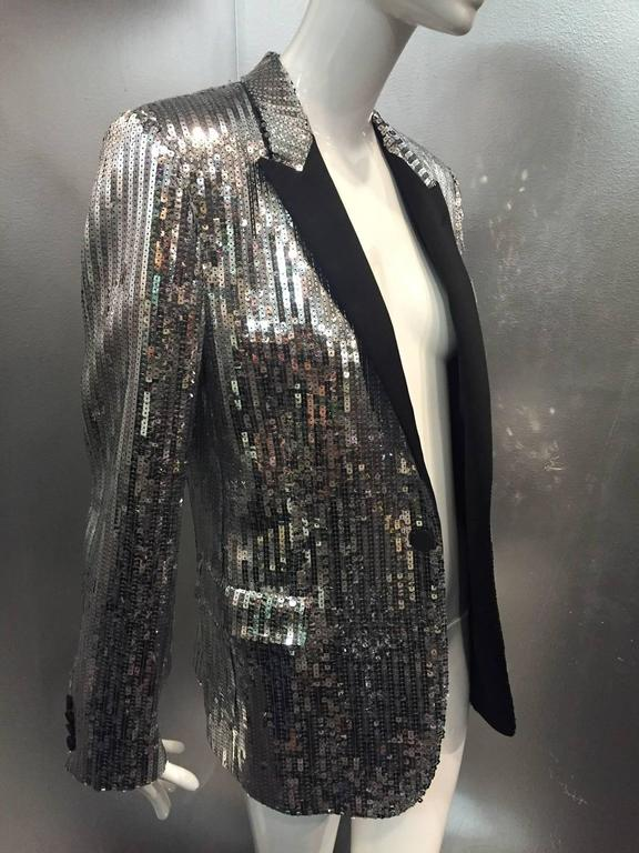 A fabulous Hedi Slimane for Saint Laurent menswear silver sequin tuxedo jacket with satin lapels!  Single button style with flap pockets.