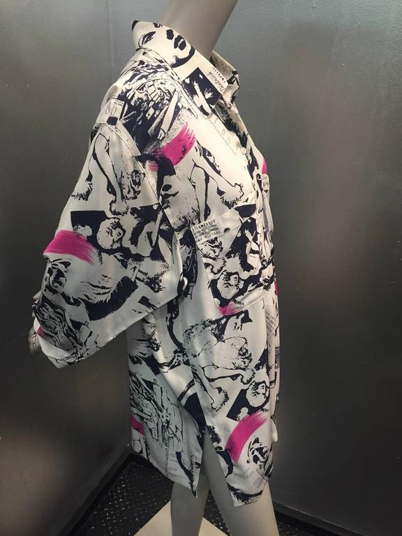 1990s Margaretha Ley for Escada iconic movie star print blouse in cream, navy and hot pink slashes.  Dolman sleeve, deep center pleat in back for a swing effect. Large front pockets. Dietrich!  Garbo!  Mae West! Chaplin!