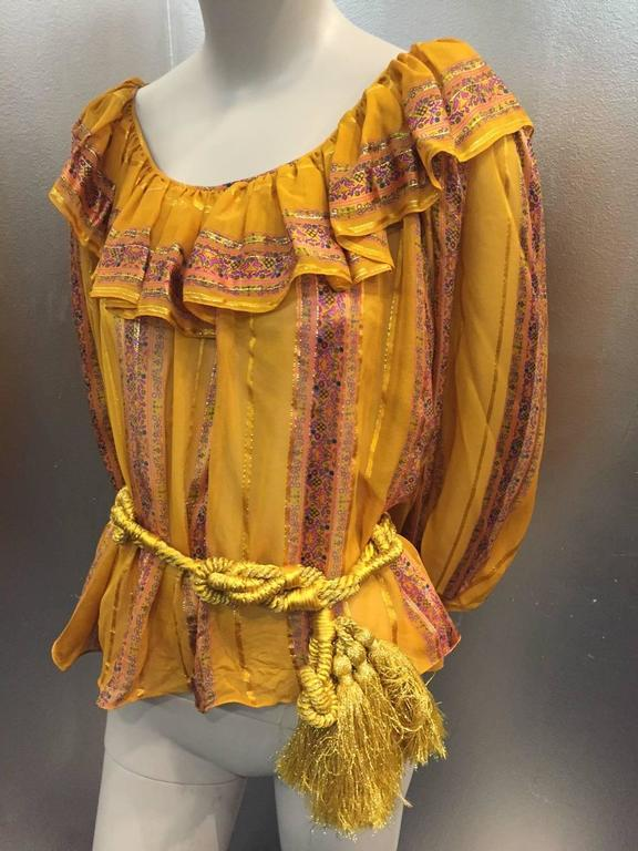 A gorgeous 1970s peasant blouse, no label Oscar de la Renta :  Elastic gathered cuffs and ruffled neckline in semi-sheer silk crepe with floral satin and lamé stripes. Original gold lamé knotted and tasseled cord belt included.
