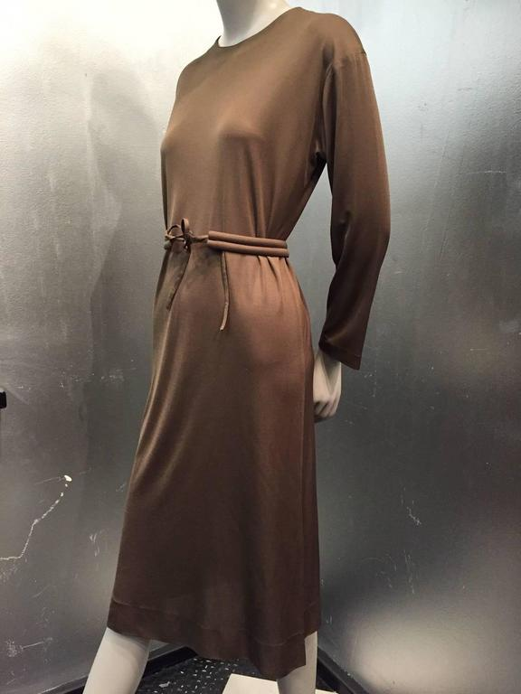 A gorgeous 1970s Emilio Pucci mocha brown silk jersey shift dress with matching structured belt. Zippered back.