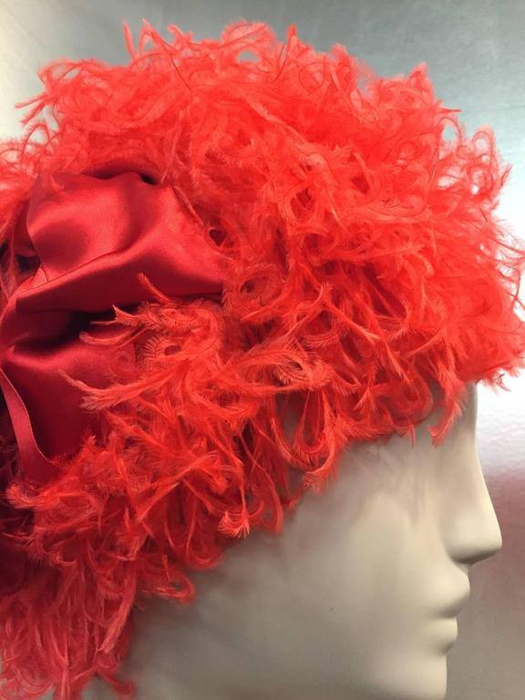 1960s Trésor structured coral red curled ostrich feather cocktail hat with charming red satin side bow  Can't do a thing with your hair?  Voila! This will take care of it.