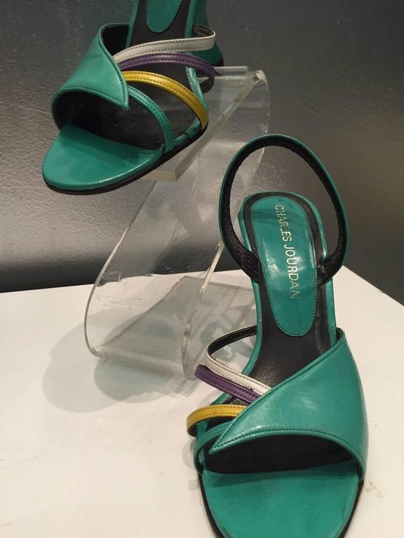 1980s Charles Jourdan turquoise slingback, open-toe sandal with white, lavender, and gold side straps and Ferragamo 1940s inspired cut-in wedge heel.  Size 5 B