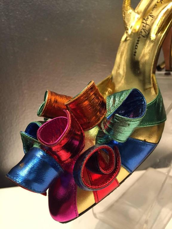 "Fabulous 1980s Beverly Feldman rainbow-hued metallic leather statement shoes!  Slingback stiletto style with closed toe and large leather spiral pom pom at the vamp.  ""Too much is not enough"" 