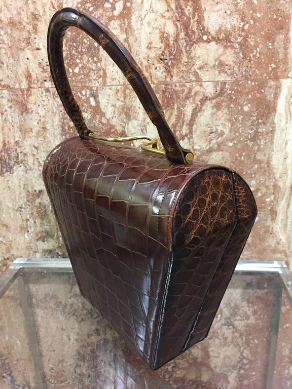 A classic tailored 1950s Koret brown alligator structured handbag with gold-tone clasp and smooth leather lining.