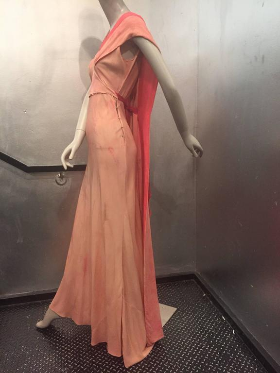 This is a simply stunning and complex 1930's bias cut gown. Featuring a subtle tie-dye pink on pink over-wash with the most beautiful foulard train. This gown has a very couture and unique look and came from a prominent old Hollywood estate. Perfect