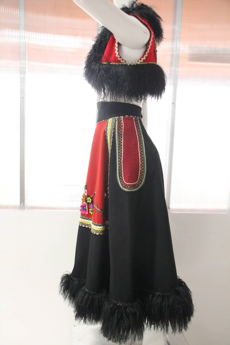 3-Piece wool felt peasant-inspired ensemble:  A-Line Black felt skirt is embellished with Mongolian lamb trim, felt and sequin applique flowers and gold rick-rack. Pouch-like purse with zipper and gold ring handles and bolero vest are both trimmed