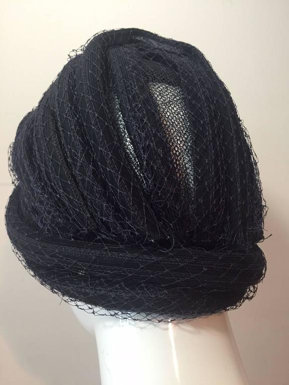 A beautiful 1960s navy blue straw and tulle Christian Dior turban.