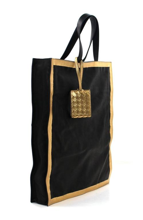 black and gold luggage tote! - its a gorgeous Steve Madden tote with almost too much space you might lose your arm when you reach in!