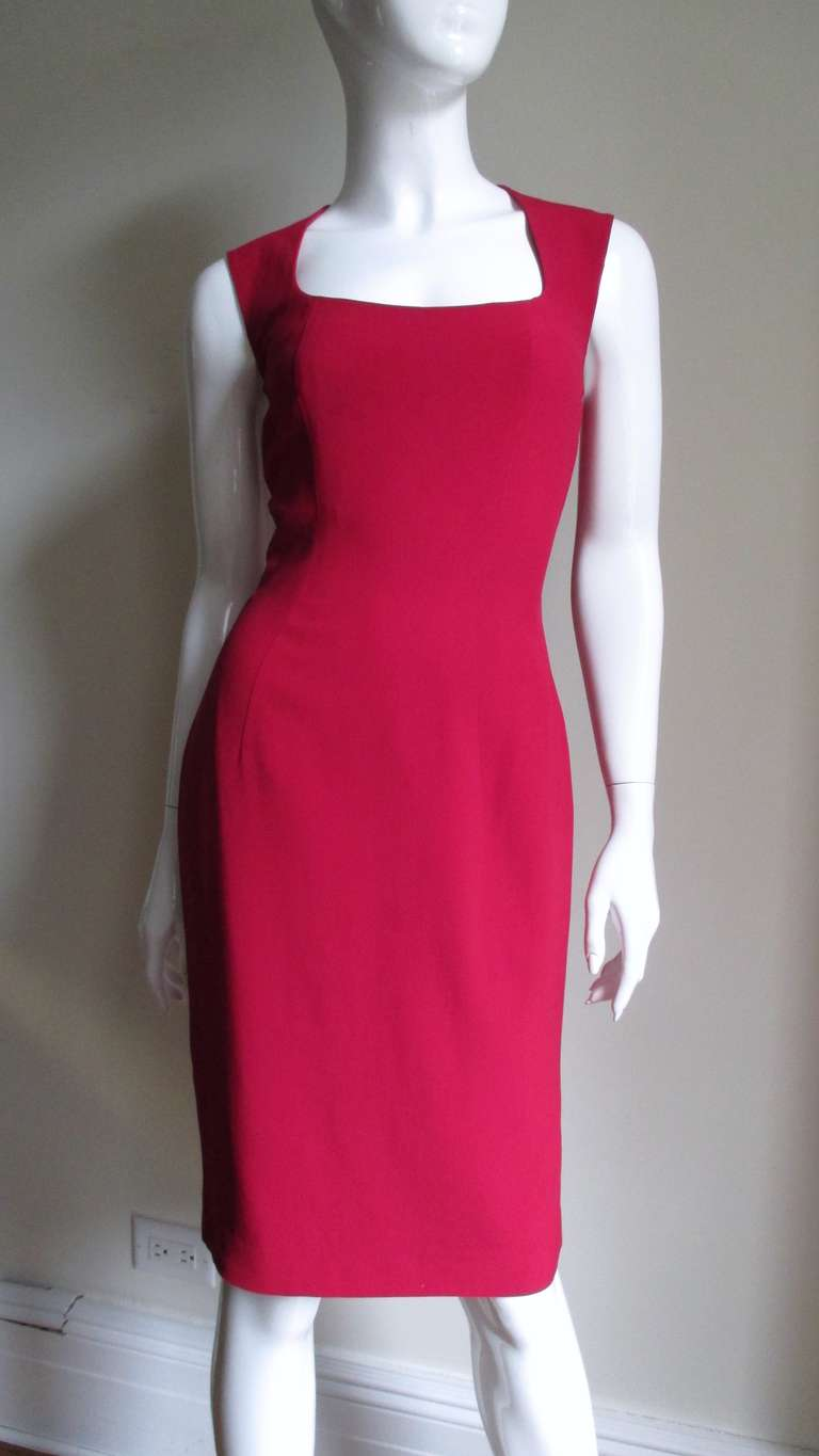 A stunning dress from Sophie Sitbon in a cranberry red rayon.  The sleeveless dress is fitted with princess seams and a square neckline.  The back is absolutely amazing with cutouts forming a circle at the upper back and cutouts forming a cross