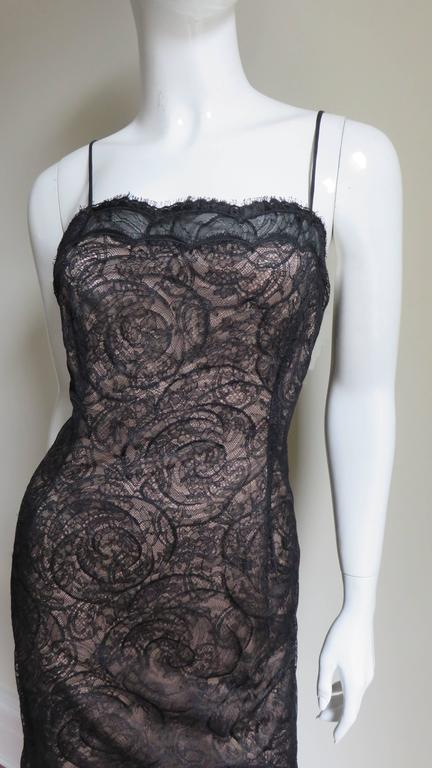 A fabulous lace slip dress by Geoffrey Beene.   It has spaghetti straps and scallop lace across the top of the dress and hem.  The lace  is intricate with an elaborate circle pattern.  The entire dress is lined in nude silk with the exception of the