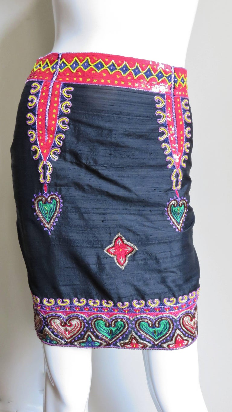 A beautiful skirt in black silk trimmed in sequins and embroidered hearts intricately decorated and framed in beading.  It has a 2