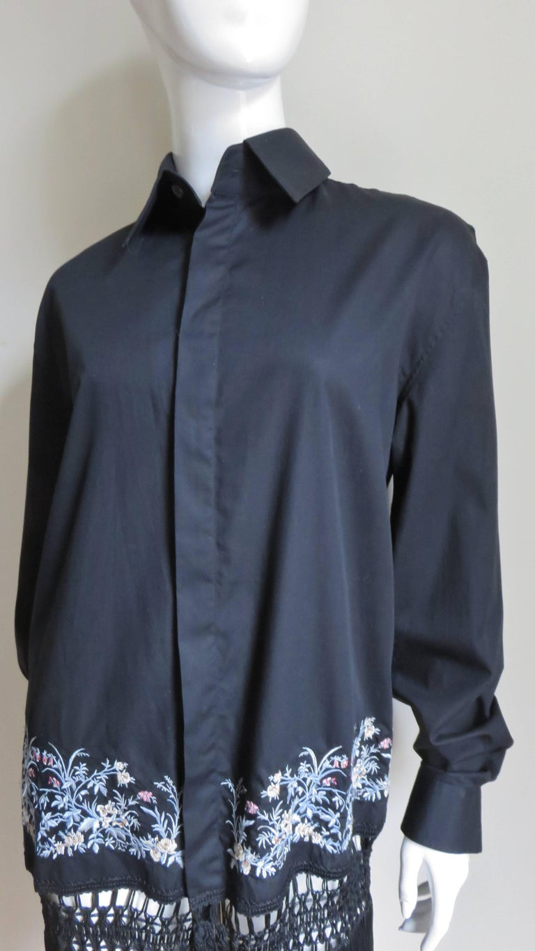 A fabulous black cotton shirt or dress by Alexander McQueen.  It is a typical shirt style differentiating itself with 3.50