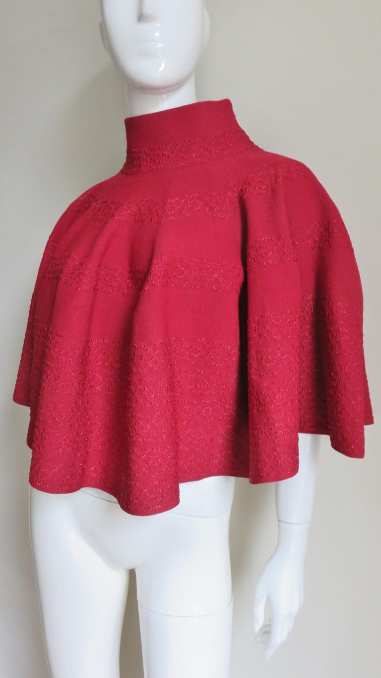A fabulous red bandage material cape poncho from Azzedine Alaia.  It has a 3