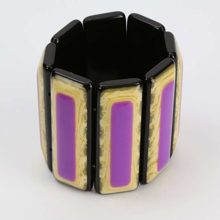 """Dramatic Vibrant Purple and Marbleized Banded Bracelet, crafted in Celluloid. Eight bands, each band measuring approx. 2.40"""" long x 0.75"""" wide. Elasticized, to fit a small, average and large wrist. Add Pizzazz to any Outfit and Light up a smile for"""