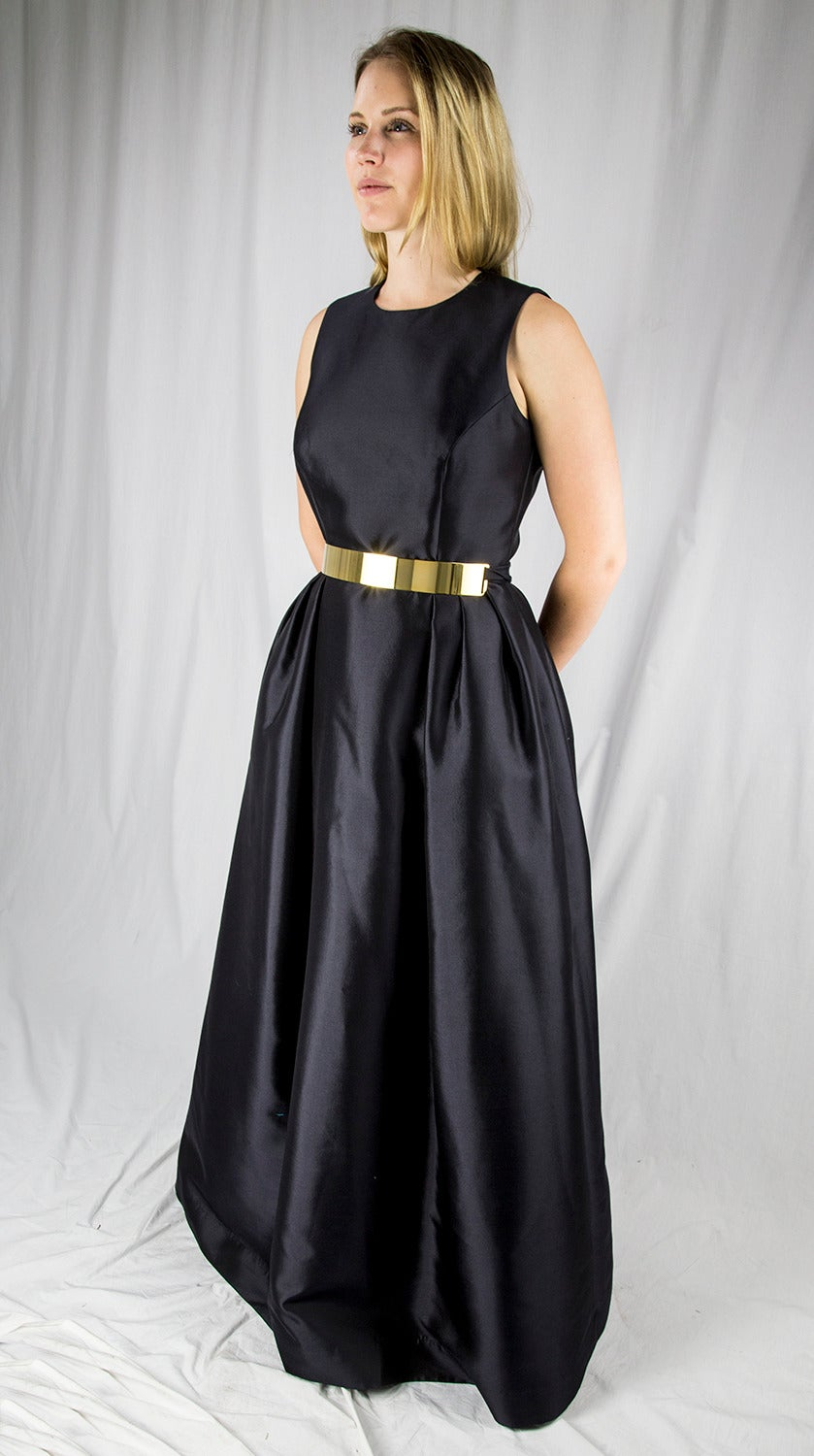 Be the Belle of the Ball in a Sensational Wayne Clark Black Gown! Pleated below the waist; fully lined.