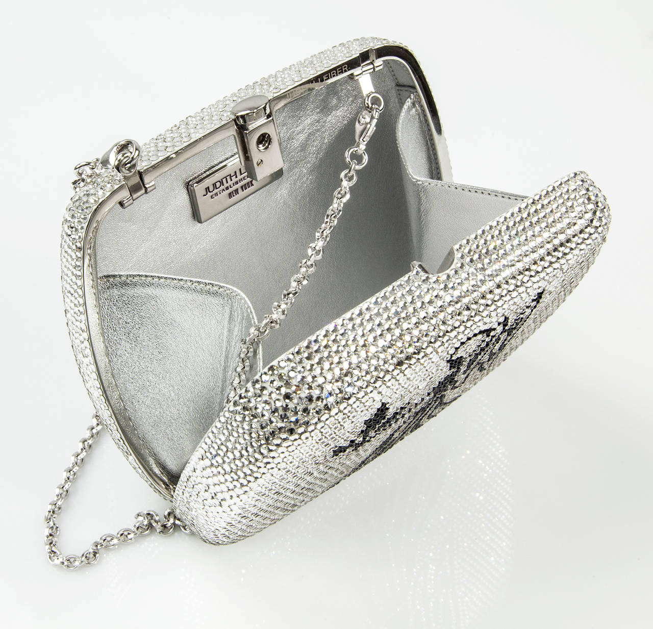 Iconic Judith Leiber Virgo Zodiac Minaudière (French for little treasure) Handbag encrusted with clear rhinestones, centered by a Lady holding branches in Black Rhinestones; Interior reveals Silver metallic Leather and signed Judith Leiber New