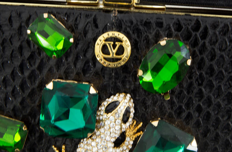 VALENTINO GARAVANI Haute Couture Black Python Clutch Bag with extraordinary jewel applications featuring a lizard completely encrusted with cut diamond like Swarovski stones and surrounded by large various cut Swarovski crystals in shades of green;