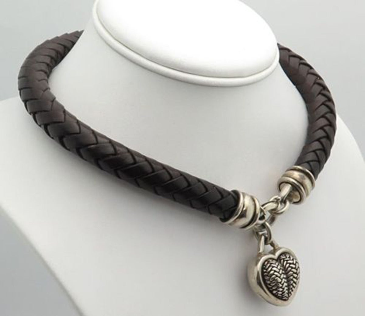 Featuring a Stunning signed BKC Sterling Silver Puffy Heart in a basket weave design, on a thick braided brown leather choker necklace, measures approx. 16