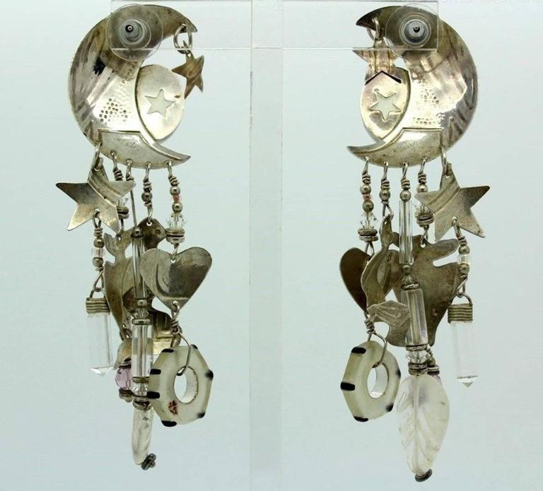 "Fabulous pair of Signed ""Mystery Artist"" Earrings, featuring Moon and Stars, Carved Moonstone Face, enhanced by Fish, Hearts, Stars, Snakes and Blown Glass Beads Dangles; crafted in Sterling Silver; Signed and marked: 925; Approx Measurements: 3.75"""