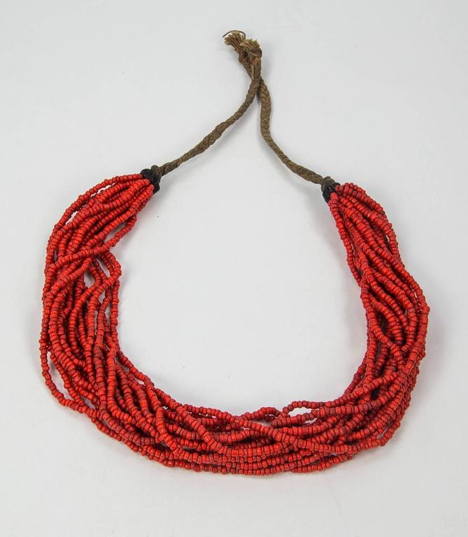 """Extraordinary wearable piece of tribal art, 20-Strand Tribal Coral Necklace features 17 twisted rows of small nugget shaped deep red coral beads, measuring approx. 5mm; approx. length of necklace: 16""""+; Unique and Fabulous as you are!"""