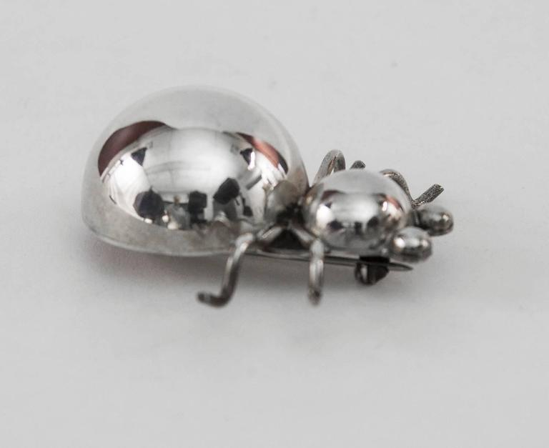 "Whimsical spider pin, crafted in sterling silver; featuring four arched silver wire legs, bulbous torso and head and protuberant eyes. Marked: MEXICO STERLING 925. Approx. size:  1.5"" long. C1950s. Add a little Pizzazz and your own Unique Style to"