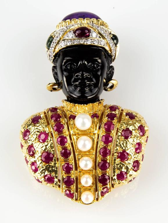 Outstanding signed Blackamoor Brooch Pin in Gilt Sterling Silver set with Rubies, Pearls and a fabulous cabochon Amethyst in Turban, surrounded by hand set crystals. Approx. size: 73.5mm x 49mm at widest point. Chic and Timeless...Illuminating your