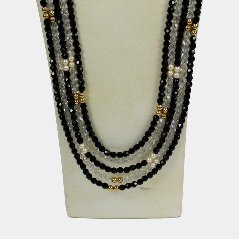 Impressive, yet understated, long eye-catching five strand Chanel inspired Swarovski Crystal beaded Necklace comprising Black, Clear CZ sparkling Czech crystal beads inter-spaced with faux pearl and gold-filled beads. Handmade intricate piece…Unique