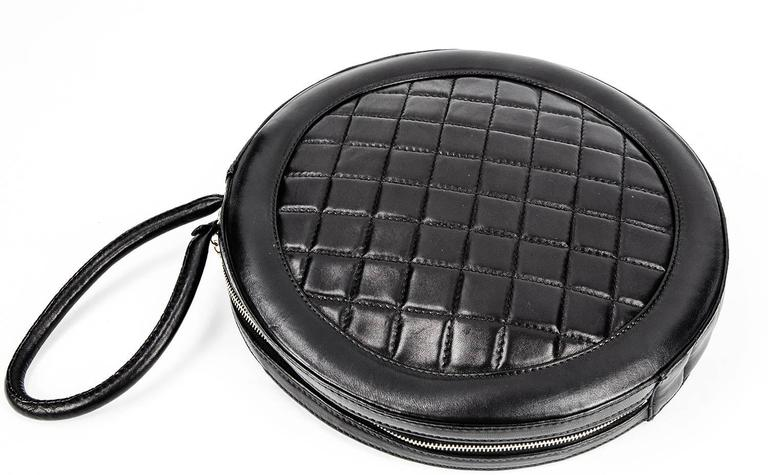 Rare and Wonderful Chanel Quilted Round Purse in new never used condition. Great Design! The 12.5