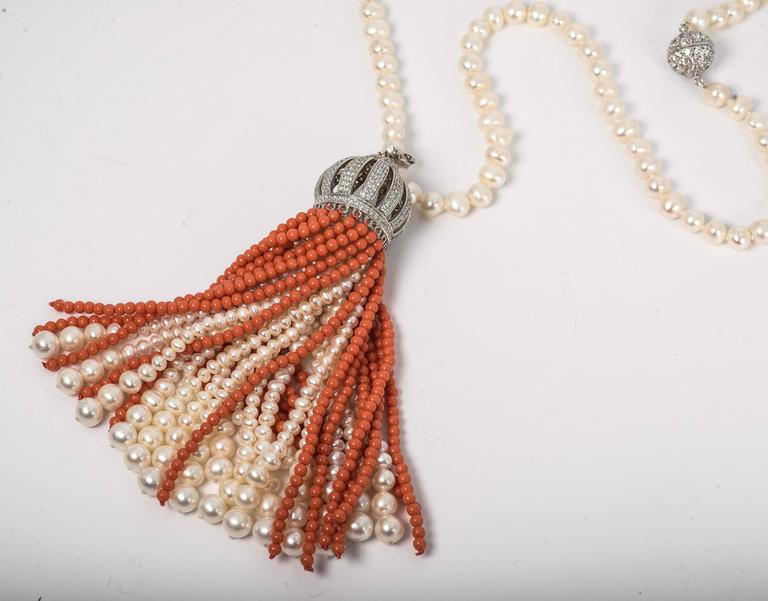 Faux coral pearl cubic zirconia pave set domed detachable tassel necklace. Strung with real freshwater pearls, this versatile elegant tassel sautoir is spectacular. The pearls when detached is a 20 inch long necklace. The tassel is  4 inches long