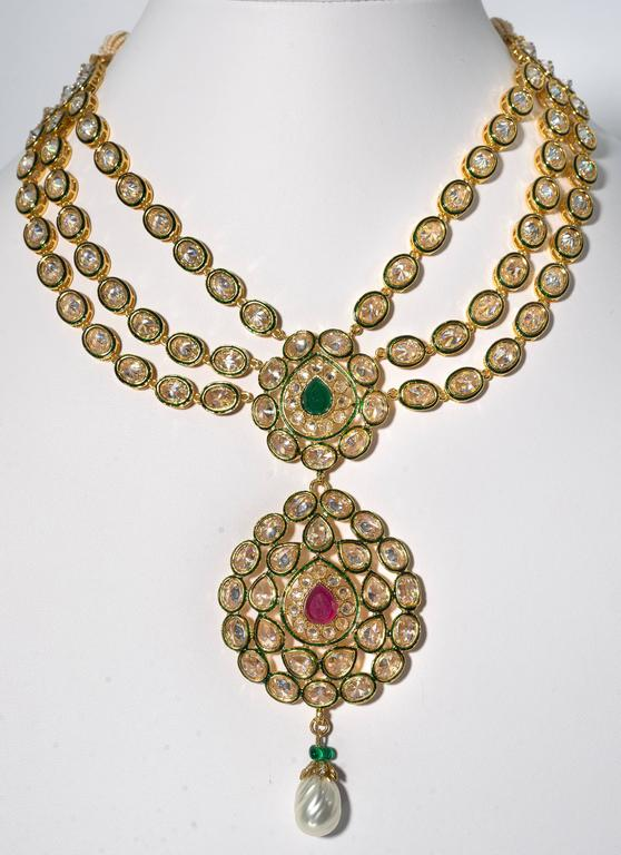 Fabulous Jewels of India Maharani glamor necklace that so inspired all the great jewelers of the 1960s to design wonderful combinations of diamonds, rubies, emeralds and pearls brought here in all faux gorgeous stones.