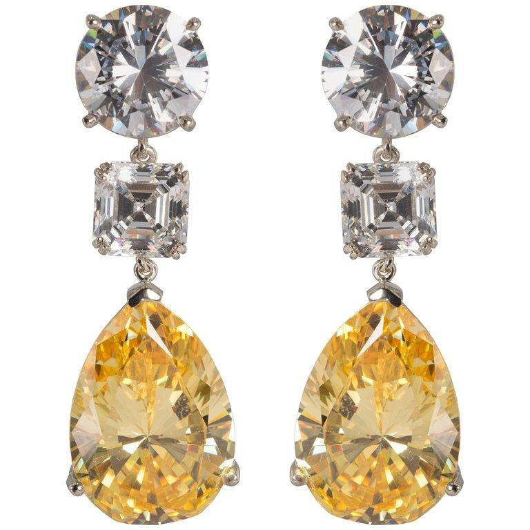 An important amazing pair of  top quality white and yellow cubic zirconia earrings. Stones so fine and exclusive they deserved to have their own GIA reports. Each round CZ has the equivalent look of a full brilliant cut 10 carat diamond, a 4 carat