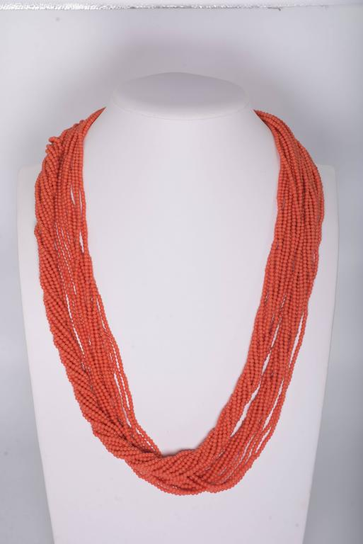 Fabulous faux 60 inch long vintage coral 4mm bead twist necklace that can be wrapped as many times as you want. So versatile and chic. Gorgeous soft coral color. Pave cubic zirconia vermeil ball screw clasp. Vintage handmade Japanese beads.