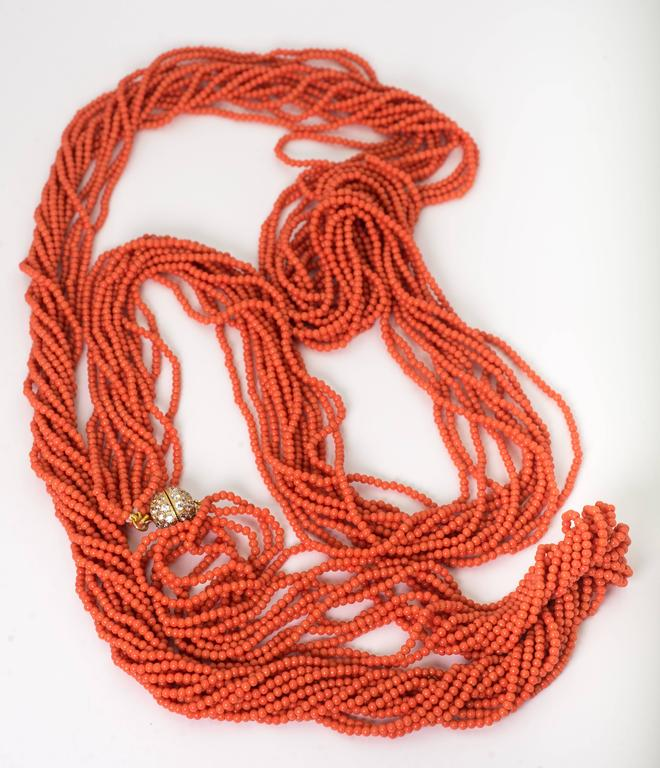 Fabulous Faux 60 Inch Long Vintage Coral Bead Twist Necklace In Excellent Condition For Sale In New York, NY