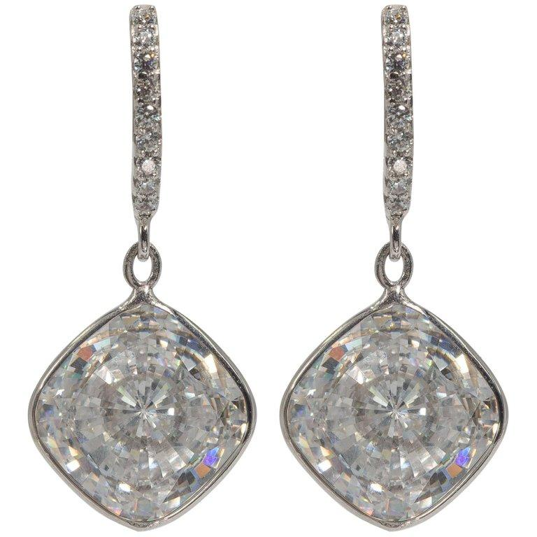 Edwardian style faux each 6 carat each CZ cushion diamond drop sterling micro-pave top earrings 1 1/4 inches long. Post safety clip