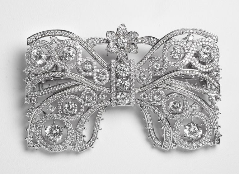 Marie Antoinette Collection garland style large faux diamond bow pin micro pave cubic zircons set in rhodium sterling makes this large 3'' wide by 2'' deep very much a statement jewel. Quite amazingly real looking and the very best quality. Please