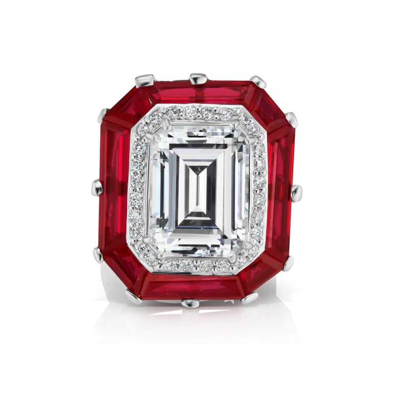 Magnificent Costume Jewelry Art Deco Style Halo Cubic Zirconia 12 Carat Emerald Cut  Diamond Man-Made Ruby Baguette with Round CZs Set All Around the Shank Sterling Ring. 1 Inch long by 1 Inch wide. Free sizing