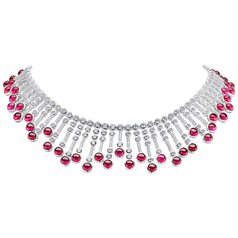 Magnificent Costume Jewelry Man-Made Cabochon Burma Ruby Diamond Fringe Sterling Silver Necklace of Alternating Gem Tipped Cubic Zirconia Set Bars Suspended from a Double Row Bezel CZ Set Sterling Silver Flexible Necklace measures 16 Inches.