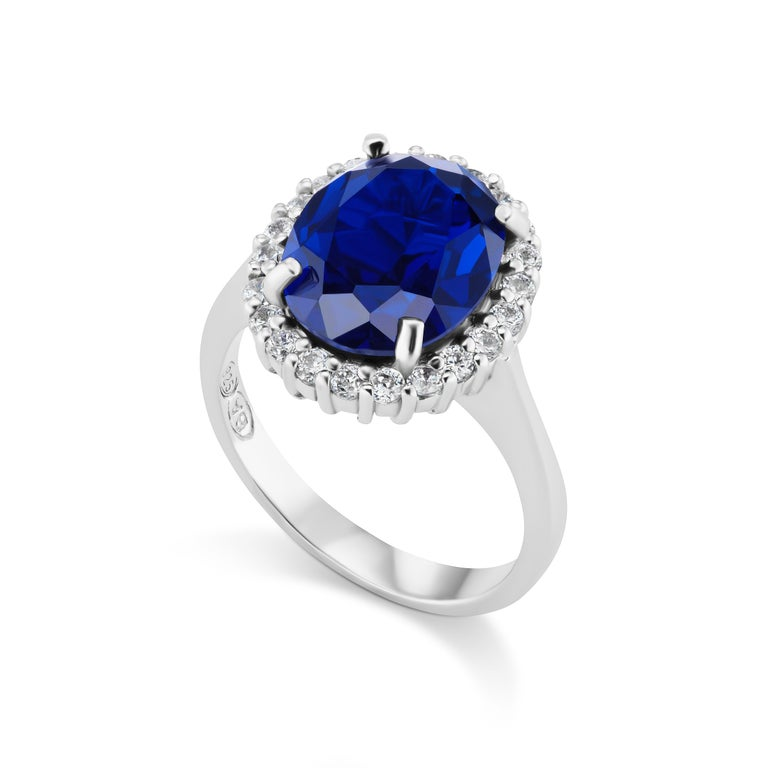 Magnificent Costume Jewelry Mini Princess Diana Man-Made 4 Carat Oval Wonderful Color Sapphire Cubic Zirconia Diamond Sterling Ring measures 1/2 inch diameter, free sizing