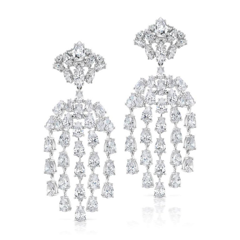 Magnificent Costume Jewelry faux marquise and pear shape diamond waterfall chandelier earrings made of scintillating CZ all flexible shimmering and chic! Hand made in rhodium sterling clip/post measure 2.50 inches long by 1 inch wide