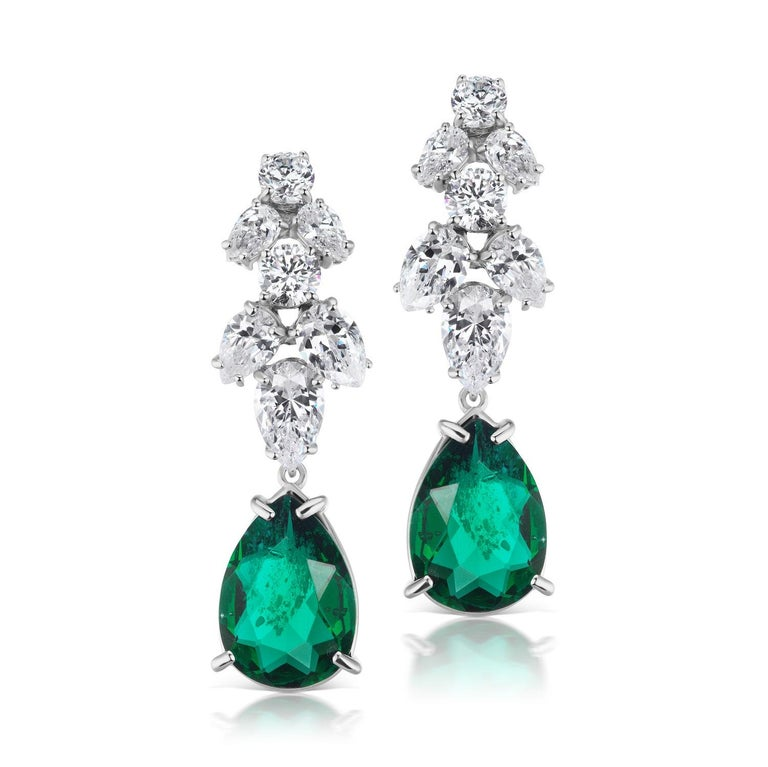 Magnificent Costume Jewelry synthetic emerald diamond delicate chandelier earrings set with marquise, pear shape and round CZ with synthetic emerald in rhodium sterling measures 2 inches long.