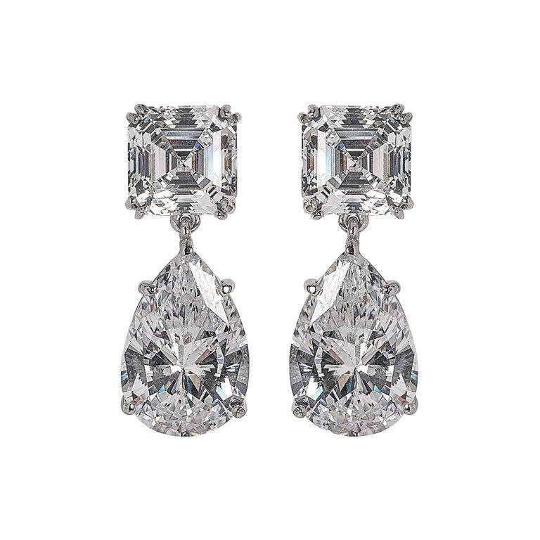 Perfect faux diamond drop earrings made with diamond cut cubic zircons set in sterling best quality ever. The top square stones are 4 carat diamond size and the pear drop are 6 carat size. Post fittings. 11/4'' long. Bright sparkly best